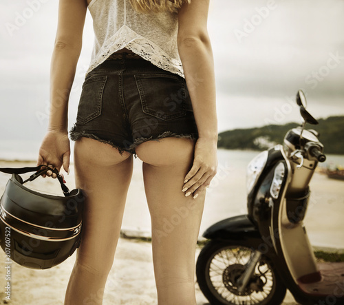 Fotobehang Konrad B. Young lady before a motorbike journey