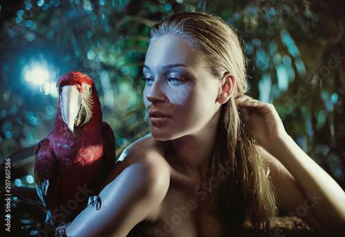 Fotobehang Konrad B. Sensual woman with a colorful parrot