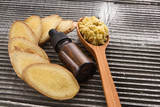 Ginger root essential oil on a dark background - 207616597