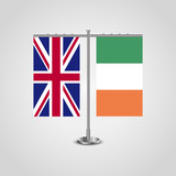 Table stand with flags of United Kingdom and Ireland.Two flag. Flag pole. Symbolizing the cooperation between the two countries. Table flags