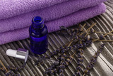 Lavender essential oil on a wooden background - 207618584