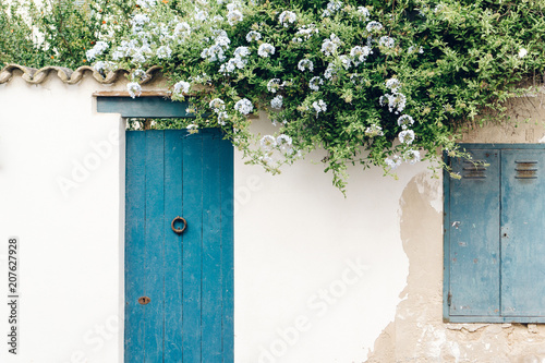 House white facade wall with flowers © Pixasquare