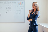 Portrait of female english teacher in front of whiteboard. - 207640330
