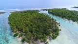 Aerial view of Motu Tautau, palm trees on little islets and turquoise crystal clear water of blue lagoon, tropical paradise of South Pacific Ocean - Tahaa island, landscape of French Polynesia - 207647566