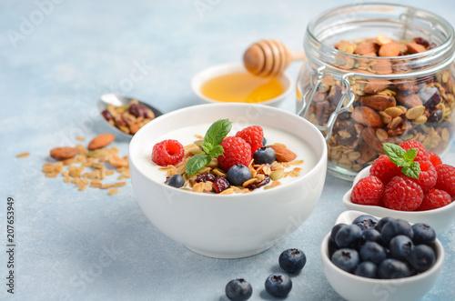 Leinwanddruck Bild Homemade granola with yogurt and fresh berries, healthy breakfast concept, selective focus.