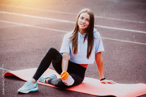 Leinwanddruck Bild healthy fitness girl with protein shake. Smile sport woman in the morning