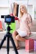 Leinwanddruck Bild - Fashion blogger recording new video for her vlog