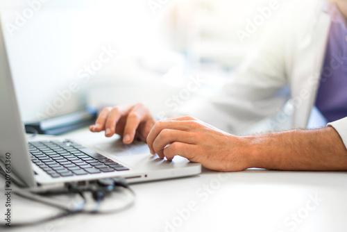 Leinwanddruck Bild Adult man pharmacist in pharmacy