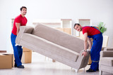 Two contractor employees moving personal belongings - 207667356
