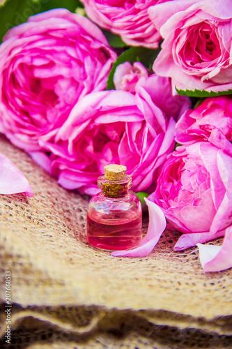 Essential oil of rose on a light background. © Erik