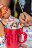 Little girl who paints ceramic funny objects - 207677100