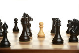 Pawn chess pawn surrounded by black opponents