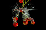 pure falling cherries into water with splash