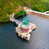 The Hracholusky dam with water power plant. The water reservoir on the river Mze. Source of renewable energy and popular recreational area in Western Bohemia. Czech Republic, Europe. - 207682381
