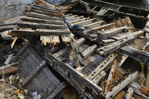 Fotobehang Schipbreuk Broken wooden boats in the river