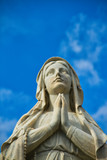 A statute of the Virgin Mary looking up while praying. - 207696717