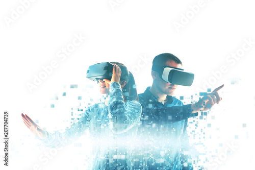 Leinwanddruck Bild A young woman and a young man in virtual reality glasses are fragmented into pixels.The concept of modern technologies and technologies of the future. VR glasses.