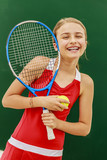 Tennis young girl player on court. - 207705373