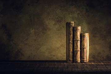 old books vintage on wood floor and paper aged background or texture
