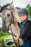 Young horse riding girl, equestrian sport . Horseback girl on field. - 207707311