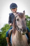 Young horse riding girl, equestrian sport . Horseback girl on field. - 207707337