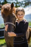 Young horse riding girl, equestrian sport . Horseback girl on field. - 207707374