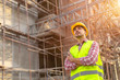 Leinwanddruck Bild - Manager Engineering in standard safety uniform working in a pouring concrete pump on construction site