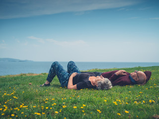 Senior couple relaxing by the coast