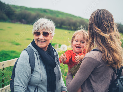 Leinwanddruck Bild Grandmother with daughter and grandchild outdoors