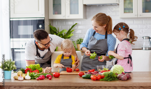 happy family with children preparing vegetable salad . - 207723566