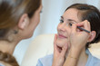 make-up artist doing make up for young beautiful bride - 207724369