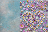 Background with flowers of daisies, lilacs, forget-me-nots, roses, petals and hearts