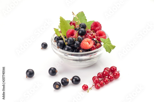 Mixed berries in glass bowl isolated on white background