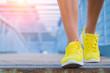 Leinwanddruck Bild - Close-up of man's running shoes while walking towards the camera.