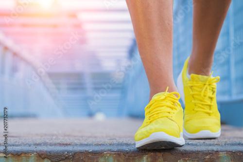 Leinwanddruck Bild Close-up of man's running shoes while walking towards the camera.