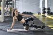 Sportive girl training in gym