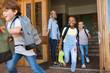 Children running outside school
