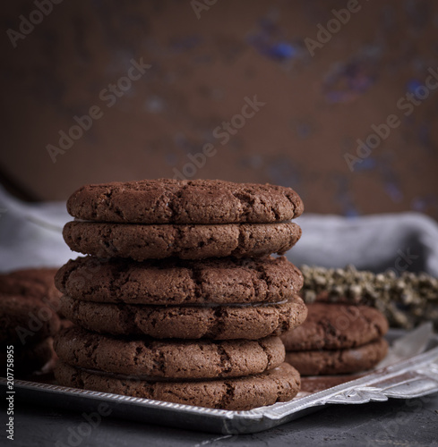 a stack of round chocolate chip cookies