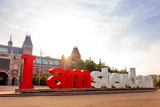 The sign i amsterdam in front of rijksmuseum in Amsterdam on sunrise - 207763573