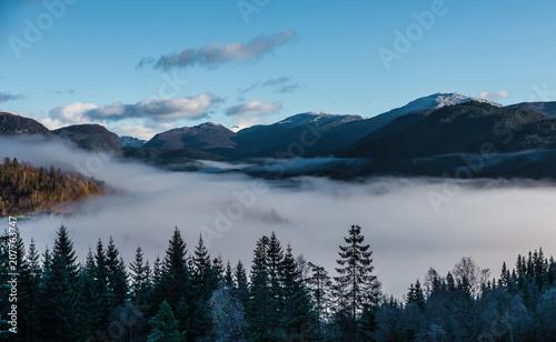 Fotobehang Blauw Clouds down