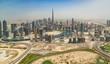 Leinwanddruck Bild - Aerial view of Dubai downtown, panoramic view from airplane window.