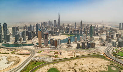 Aerial view of Dubai downtown, panoramic view from airplane window.