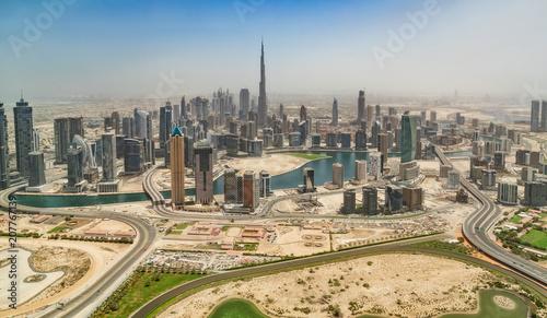 Leinwanddruck Bild Aerial view of Dubai downtown, panoramic view from airplane window.