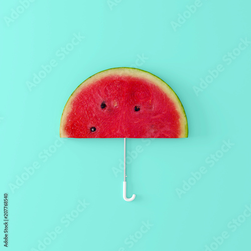 Watermelon umbrella on pastel blue background. Creative idea. minimal concept © aanbetta