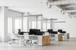 Leinwanddruck Bild - White open space office interior side view