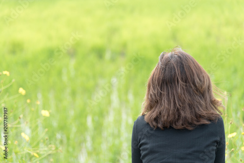 Asian woman relaxing in the green forest