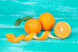 orange fruit on color table background. - 207795359