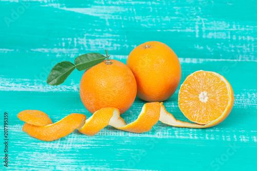 orange fruit on color table background.
