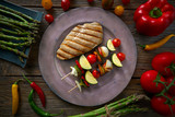 grilled chicken breast with brochette vegetable - 207804907
