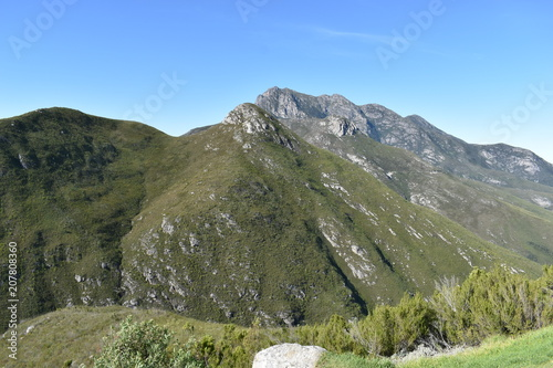 Fotobehang Khaki Mountainous landscape on the way to Wilderness in South Africa